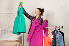Girl chooses dresses Stock Image