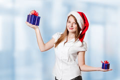 Girl chooses gift Royalty Free Stock Images
