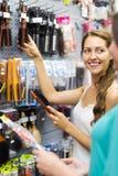 Girl chooses hairbrush Royalty Free Stock Photo