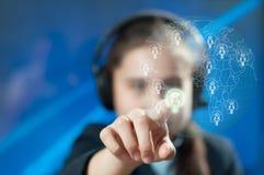 Girl chooses interlocutor for dialogue. Girl with headphones selects interlocutor for dialogue Royalty Free Stock Image