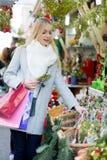 Girl chooses mistletoe Royalty Free Stock Photography