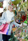 Girl chooses mistletoe Royalty Free Stock Photo