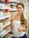 Girl chooses perfume in the shop Royalty Free Stock Images