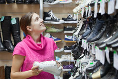 Girl chooses sporty shoes Royalty Free Stock Photos