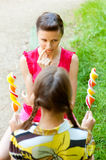 Girl chooses sugar candy Stock Images