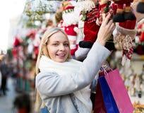 Girl chooses to holiday decor Stock Photos