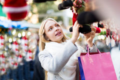 Girl chooses to holiday decor Stock Photography