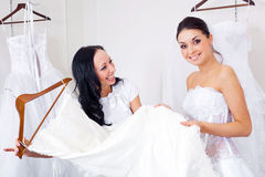 Girl Choosing A Wedding Dress Royalty Free Stock Photography