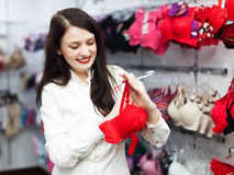 Girl choosing bra at fashion boutique Royalty Free Stock Photos