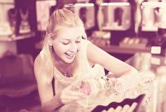 Girl choosing bracelet in bijouterie shop Stock Photos
