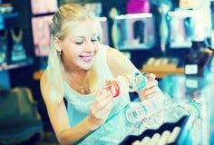 Girl choosing bracelet in bijouterie shop Royalty Free Stock Photos