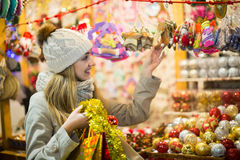 Girl choosing Christmas gifts outdoor Royalty Free Stock Photography