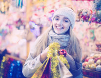 Girl choosing Christmas gifts outdoor Royalty Free Stock Image