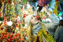 Girl choosing Christmas gifts outdoor Stock Photo