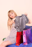 Girl  choosing clothes Royalty Free Stock Photo