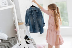 Girl choosing clothes for daily look royalty free stock photos