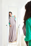 Girl choosing clothes in a showroom Royalty Free Stock Photography
