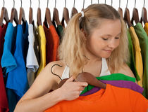 Girl choosing clothes in a store Stock Photos