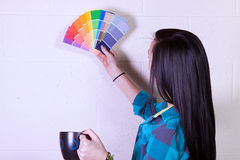 Girl Choosing a Color for the Walls Royalty Free Stock Images