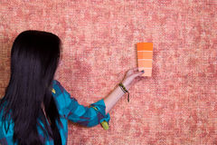 Girl Choosing a Color for the Walls Royalty Free Stock Photos