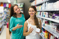 Girl choosing cream at the shop Stock Image