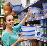 Girl choosing cruet-stands in the shop Stock Images