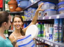 Girl choosing cruet-stands in the shop Stock Photography