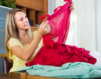 Girl choosing curtains for interior Royalty Free Stock Image