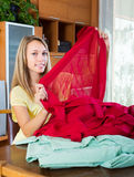 Girl choosing curtains for interior Stock Image