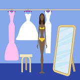 Girl choosing dress Royalty Free Stock Photos