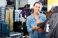Girl choosing handbag in store Stock Image
