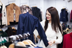 Girl choosing jacket at boutique Stock Image