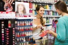 Girl choosing nail polish at store Royalty Free Stock Photos
