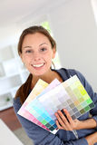 Girl choosing paint colour Royalty Free Stock Photography