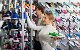 Girl choosing shoes in store Royalty Free Stock Photos