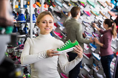 Girl choosing shoes in store Royalty Free Stock Image