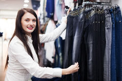Girl choosing trousers Royalty Free Stock Photo