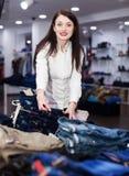 Girl choosing trousers Stock Photo