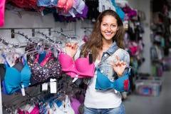 Girl choosing underwear at shop Royalty Free Stock Photography