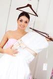 Girl choosing a wedding dress Stock Photos