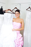 Girl choosing a wedding dress Royalty Free Stock Images