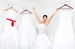 Girl choosing a wedding dress Royalty Free Stock Image