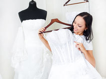 Girl choosing a wedding dress Royalty Free Stock Photos