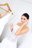 Girl choosing a wedding dress Stock Photography