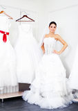 Girl choosing a wedding dress Stock Photo