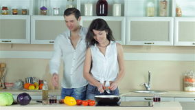 The girl chopped carrots, boy kissing a girl and stock video