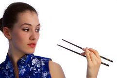 Girl with chopstick 2. White girl with chopstick on the white background royalty free stock photography