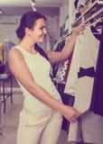 Girl chousing dress Royalty Free Stock Photos