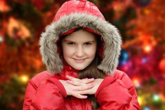 Girl and Chrismas tree Stock Images