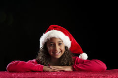 Girl with christas hat on black Royalty Free Stock Photo